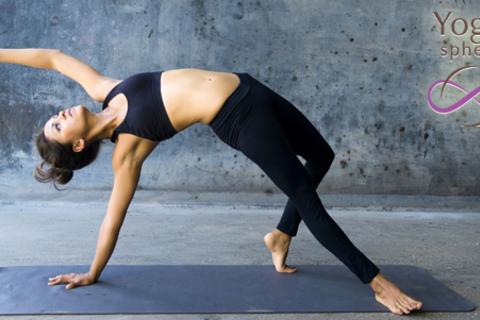 Расслабление и достижение новых высот! 12 занятий йогой в студии Yoga sphera со скидкой 50% от КупиКупон
